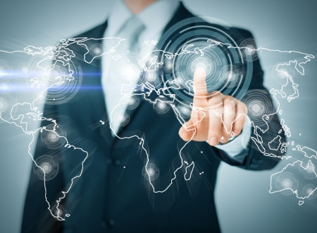 Foto de business, technology, internet and networking concept - businessman pressing button with contact on virtual screens - Imagen libre de derechos