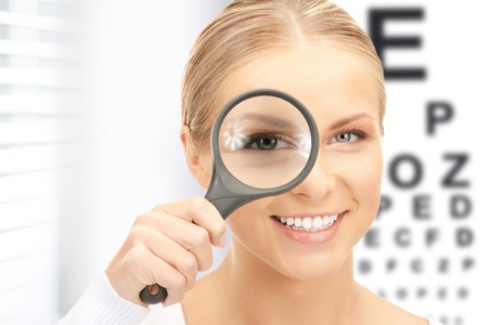 Photo for medicine and vision concept - woman with magnifier and eye chart - Royalty Free Image