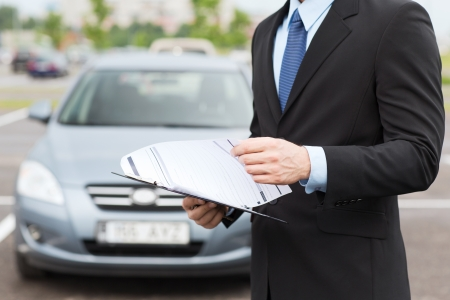 Foto de transportation and ownership concept - man with car documents outside - Imagen libre de derechos