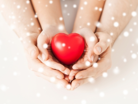 Photo for close up of woman and man hands with heart - Royalty Free Image