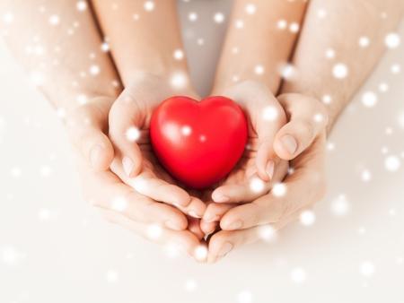 Foto de close up of woman and man hands with heart - Imagen libre de derechos