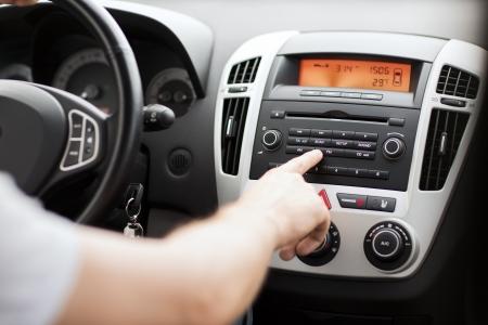 Foto de transportation and vehicle concept - man using car audio stereo system - Imagen libre de derechos