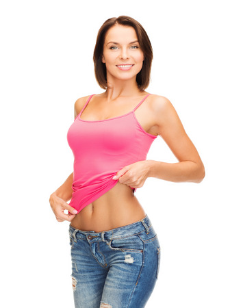 Photo pour health, diet and beauty concept - happy woman taking off blank pink tank top or showing abs - image libre de droit