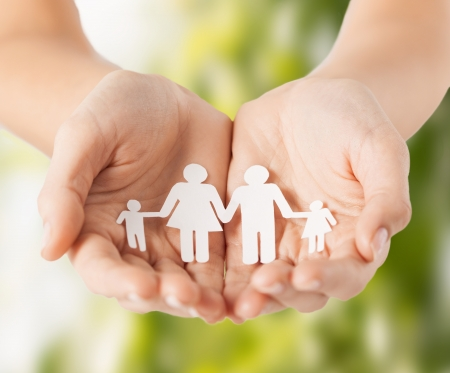 Photo for eco, bio, nature, love, harmony concept - woman cupped hands showing paper man family - Royalty Free Image
