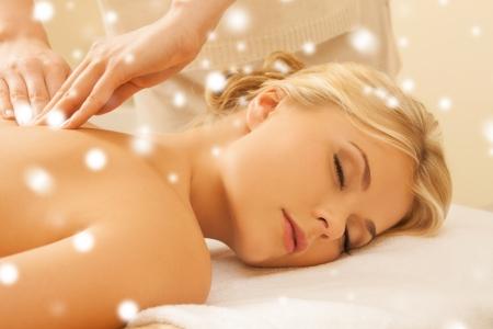 Photo pour health and beauty concept - woman in spa salon getting massage - image libre de droit