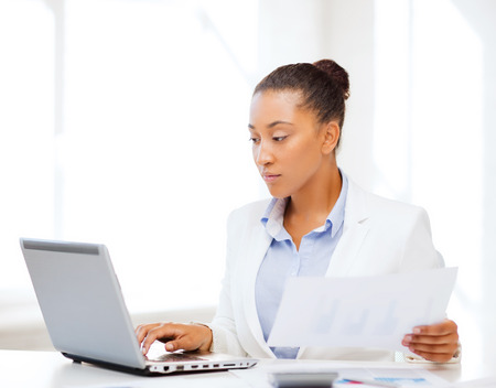Photo pour business and tax concept - african businesswoman working with computer in office - image libre de droit