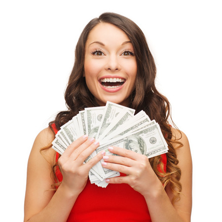 Foto de christmas, x-mas, sale, banking concept - smiling woman in red dress with us dollar money - Imagen libre de derechos