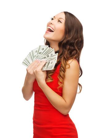 Foto de christmas, x-mas, sale, banking concept - smiling woman in red dress with us dollar money - Imagen libre de derechos