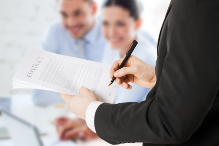 Foto de office, buisness, legal, teamwork concept - man signing contract - Imagen libre de derechos