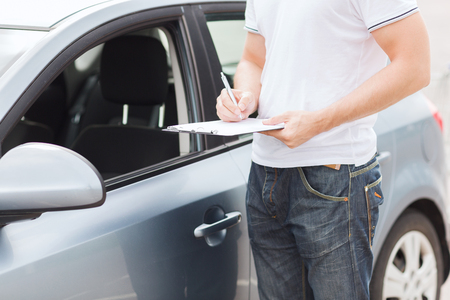 Photo pour transportation and ownership concept - man with car documents - image libre de droit