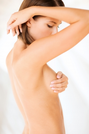 Photo pour health, medicine, beauty concept - woman checking breast for signs of cancer - image libre de droit