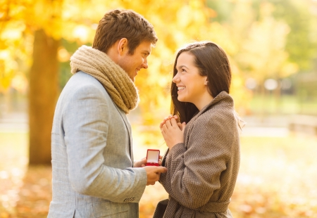 Photo for holidays, love, couple, relationship and dating concept - romantic man proposing to a woman in the autumn park - Royalty Free Image