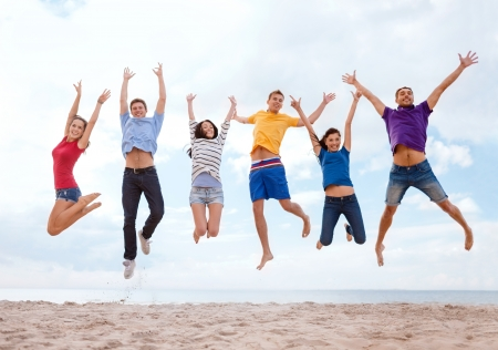 Photo for summer, holidays, vacation, happy people concept - group of friends jumping on the beach - Royalty Free Image