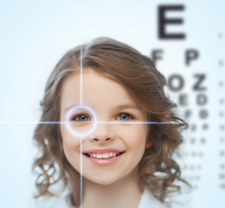 Foto de health, vision, medicine, laser correction, happy people concept - smiling pre-teen girl with optometric table or eyesight testing board - Imagen libre de derechos