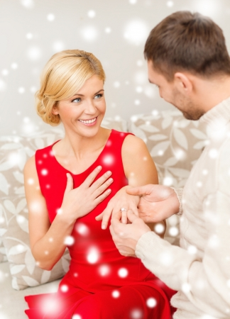 Photo pour love, couple, relationship and dating concept - romantic man proposing to a woman in red dress - image libre de droit