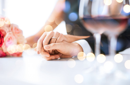 Photo pour love, family, anniversary concept - engaged couple with wine glasses in restaurant - image libre de droit