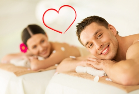 Photo pour spa, beauty, love and happiness concept - smiling couple lying on massage table in spa salon - image libre de droit