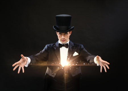 Photo for magic, performance, circus, show concept - magician in top hat showing trick - Royalty Free Image