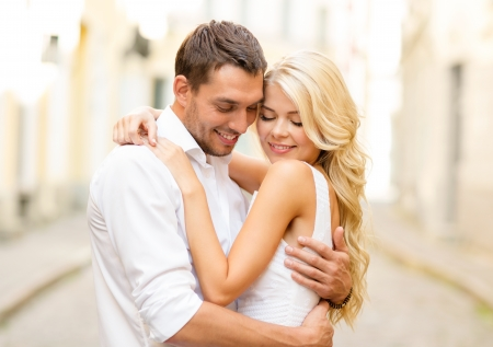 Photo pour summer holidays, love, travel, tourism, relationship and dating concept - romantic happy couple hugging in the street - image libre de droit
