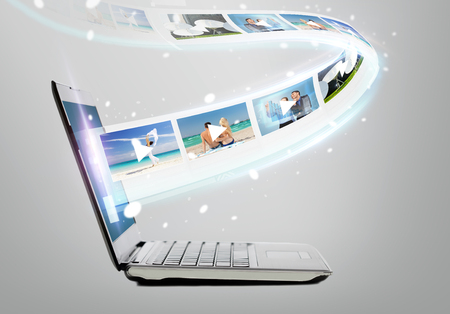 Photo for technology, internet and video concept - laptop computer with video on screen - Royalty Free Image