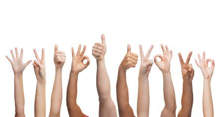 Foto de gesture and body parts concept - human hands showing thumbs up, ok and peace signs - Imagen libre de derechos