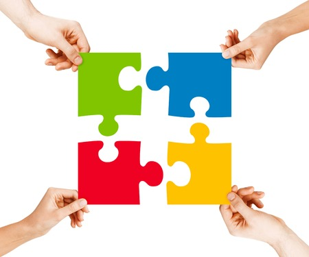 Photo pour business, teamwork and collaboration concept - four hands connecting colorful puzzle pieces - image libre de droit