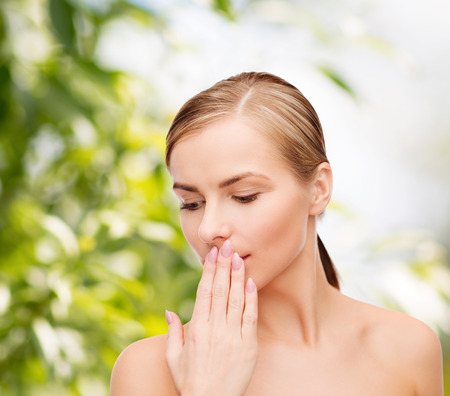 Foto de health and beauty concept - clean face of beautiful young woman covering her mouth with hand - Imagen libre de derechos