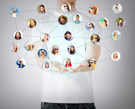 Foto de networking and communication concept - closeup of mans hands showing social network - Imagen libre de derechos