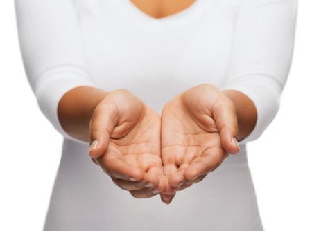 Photo pour people and advertisement concept - close up of womans cupped hands showing something - image libre de droit