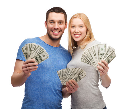 Foto de smiling couple holding dollar cash money - Imagen libre de derechos