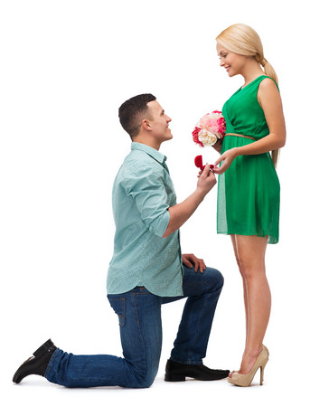 Photo for happiness, proposal, engagement and celebration concept - smiling couple with flower bouquet and ring in a box - Royalty Free Image