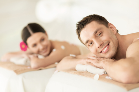 Photo for picture of couple in spa salon lying on the massage desks - Royalty Free Image