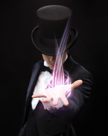 Photo for magic, performance, circus, show and advertisement concept - magician holding something on palm of his hand - Royalty Free Image