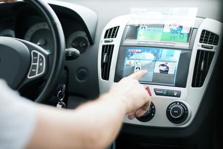 Foto de transportation and vehicle concept - man using car control panel to read news - Imagen libre de derechos