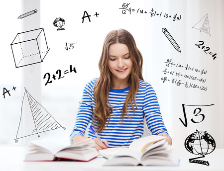 Foto de education and home concept - happy smiling student girl with books - Imagen libre de derechos