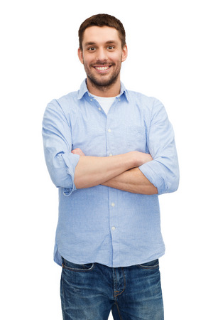 Photo for happiness and people concept - smiling man with crossed arms - Royalty Free Image