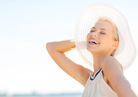 Photo for fashion, happiness and lifestyle concept - beautiful woman in hat enjoying summer outdoors - Royalty Free Image