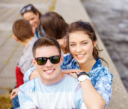 Photo for summer holidays, relationships and teenage concept - smiling teenagers having fun outside - Royalty Free Image