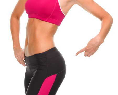 Foto de fitness and diet concept - close up of sporty woman pointing at her buttocks - Imagen libre de derechos