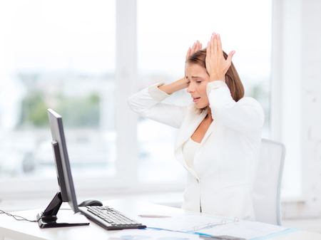 Foto de business, office, school and education concept - stressed businesswoman with computer at work - Imagen libre de derechos