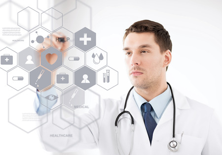 Foto per healthcare, medical and future technology concept - male doctor with stethoscope and virtual screen - Immagine Royalty Free