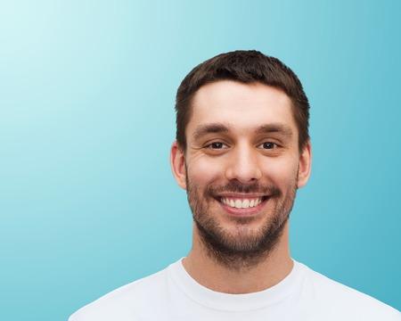 Photo pour health and beauty concept - portrait of smiling young handsome man - image libre de droit