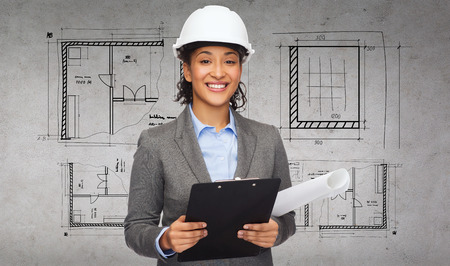 Foto für building, developing, construction and architecture concept - smiling businesswoman in white helmet with clipboard and blueprint - Lizenzfreies Bild