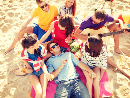 Photo for summer, holidays, vacation, music, happy people concept - group of friends with guitar having fun on the beach - Royalty Free Image