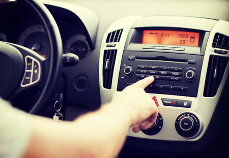 Photo for transportation and vehicle concept - man using car audio stereo system - Royalty Free Image