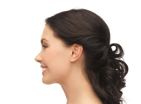 Foto de beauty and health concept - profile portrait of smiling young woman - Imagen libre de derechos