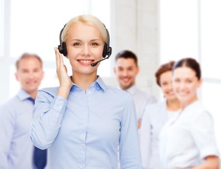 Photo pour business, technology and call center concept - friendly female helpline operator with headphones - image libre de droit
