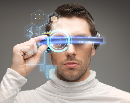 Foto de future, technology and people concept - man in futuristic glasses - Imagen libre de derechos
