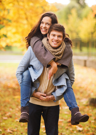 Photo pour love, relationship, family and people concept - smiling couple hugging in autumn park - image libre de droit