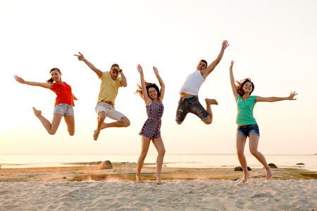 Photo for friendship, summer vacation, holidays, party and people concept - group of smiling friends dancing and jumping on beach - Royalty Free Image